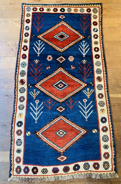 Fine antique qashqai gabbeh rug ca 1900 size 209 x 109 cm. great wool and outstanding natural dyes  Very good condition few tiny repairs missing outer blue guard at bottom original selvedges  ...