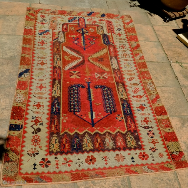 A Melas 'Mejideh' Prayer Rug from the second half of the 19th century Size 89.5 x 151.5cm  A fine Melas prayer rug with excellent drawing and good colours and an unusual white main border  ...