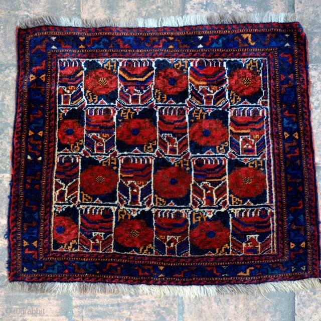 A Khamseh Khorjin/Bagface   Size 70 x 61.5 cm  An unusual compartmentalised Khamseh bagface with full pile and all natural colours, (kilim ends have been removed). The motifs are highly abstracted and suggest roses(pomegranates?)  ...