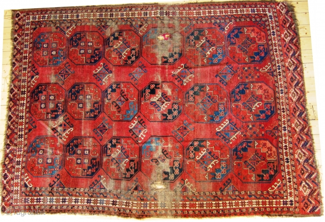 Mid 19th Century Ersari main carpet, damaged but beautiful, with a rare quartered gull design  and unusual dyrnak secondary guls, pile is mostly full at both ends though there are two  ...