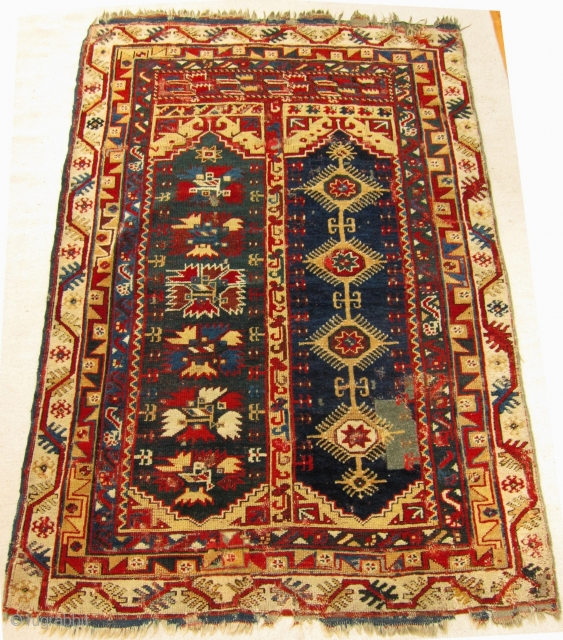 Mid-19th Century Makri/Megri two panel rug size 198cm x 135cm.  Fabulous colours including an unusual dark-blue green in one panel and two yellows. Wear, repairs, the rug is largely intact. Kilim ends have  ...