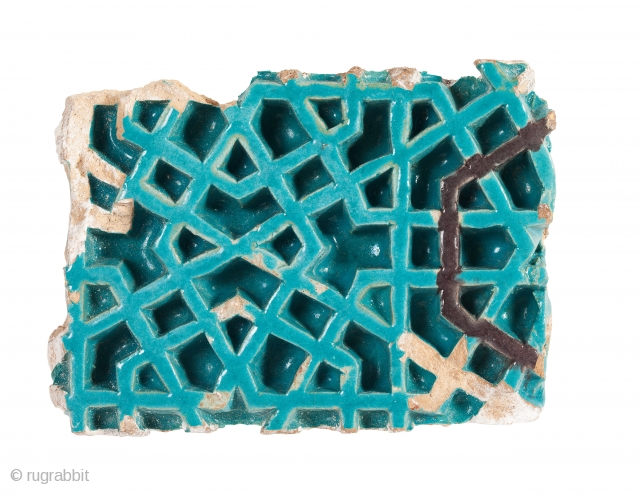 Timurid tile fragment, of rectangular form, decorated with a deeply incised geometric design, painted with turquoise and manganese glazes Samarkand, early 15th century L. 17 cm; W. 12.7 cm Published: Arts from the Land of  ...
