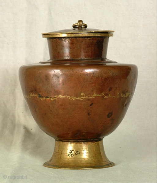 Tibetan Vase. Copper and brass. Second half of 19th cent. or beginning of 20th. The writing says 'Chort' 'Offering'