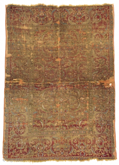 Lot 147, KAIRO FRAGMENT 177 x 126 cm (5ft. 10in. x 4ft. 2in.) Egypt, 16th century Condition: fragment, several repairs and age-related signs of use Warp: wool, weft: wool, pile: wool.   The  ...