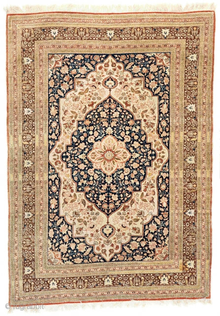 "Antique Tabriz 'Haji Jalili' rug. c 1910. Size: 120x172cm (3'11""x5'7""). Overall good conditon, good pile, some small areas have low pile, slight stain in one place. The rug was hung on the  ..."