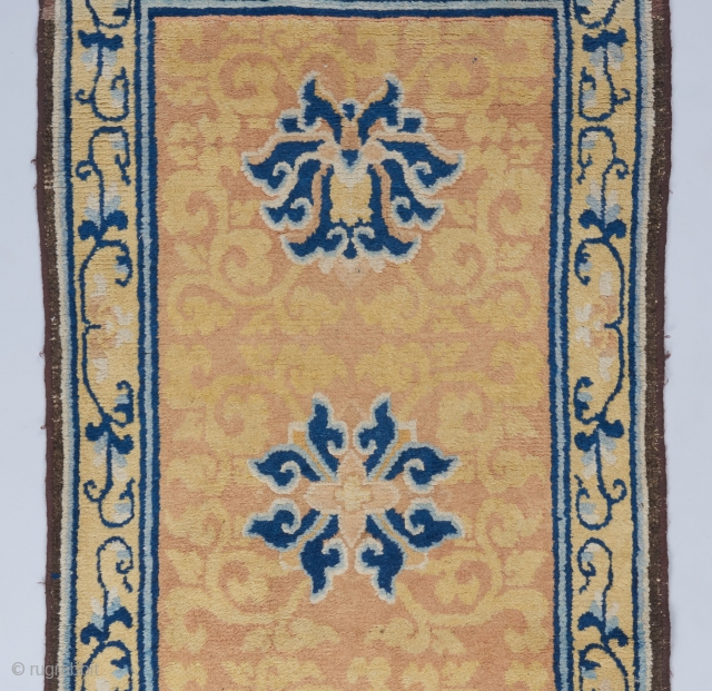 Late 18th/early 19th century Ningxia runner reduced in length as many of these are. One whole end border rewoven and the outer guard border on the other end rewoven. The rest is  ...