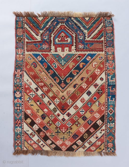 An authentic Caucasian village prayer rug with lovely color and very good age. This one's got some zest!! Please ask for more info.   Visit our website for more collectible weavings : www.bbolour.com  ...