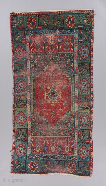 An early 19th century North African rug with a Ladik design rendered in a singular color palette. Contains some writing at the top. A rare and beautiful piece which is worthy of  ...
