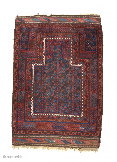 A gorgeous timuri Baluch with great color and an interesting design , especially the border scheme and the mihrab within the mihrab. A cut/ crease towards the top that is visible in  ...