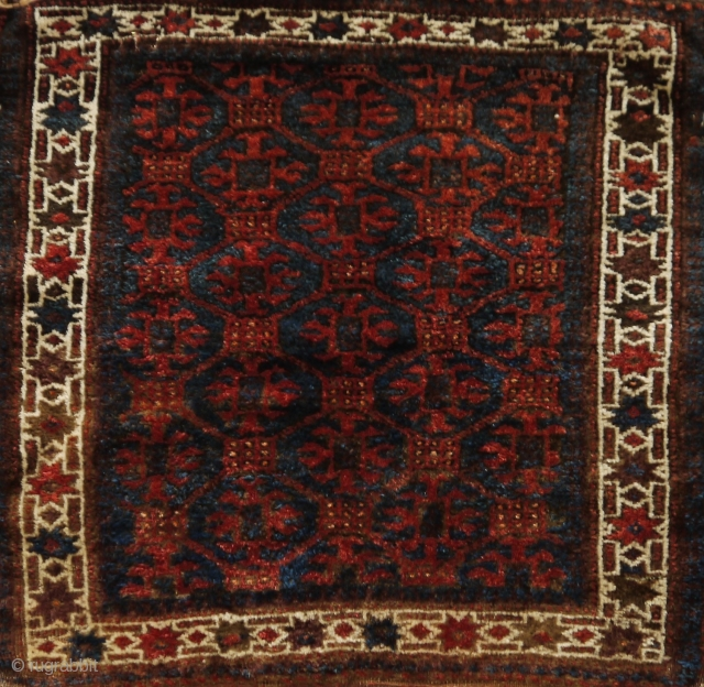 Baluch bag face with lattice design, full pile, some slight traces of use at the border, natural colours except for a few green knots.   72 x 73 cm.