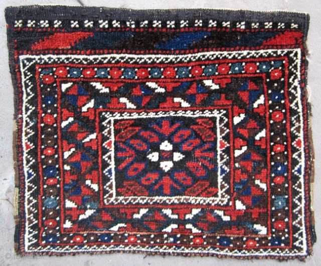 Very unusual Baluch bagface. Small format, almost like a chanteh. All good colors and very good condition. More age than may appear. I think late 19th century. The kilim design at the  ...