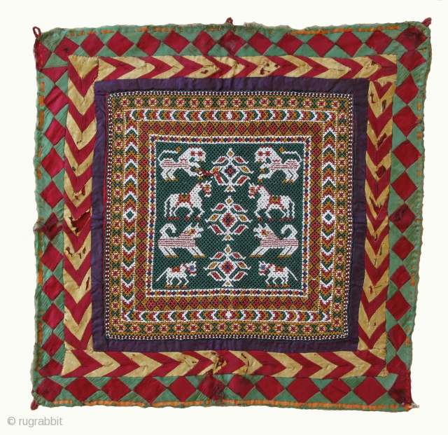 Beadwork Wallhanging 44x44cm; beaded part 27x27cm Kathiawar, Gujarat, India) 19/20th century Perfect condition  The method of work is a tri-bead system (tran moti-no thansiya), worked row-by-row, three beads being taken up at each stitch; on the  ...