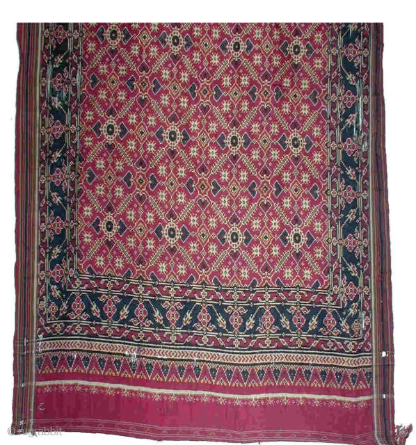 Patola Sari (double Ikat) 112x440cm Patan, Gujarat, India) 19th century Silk  Because the sari has been worn a lot and had some holes, it was professionally mounted on a thin red cotton cloth. The colours are very  ...