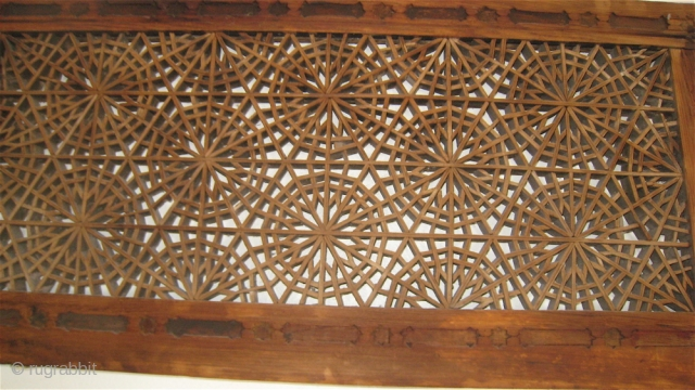 Wood ventilation window covering from the old city of Peshawar.  Nails in the frame, but the center is made of tiny pieces of wood held together by pressure and balance.   ...