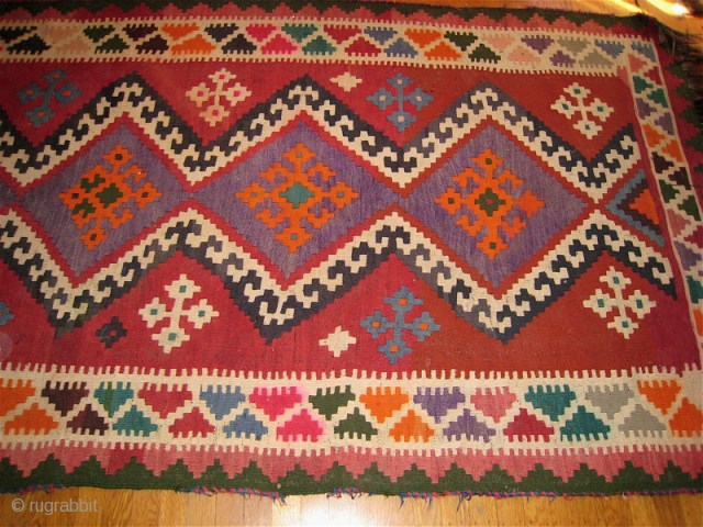 Afghan kilim, thick, all wool.  54 inches by 138 inches.  Pink dye in border design element has run slightly.  No holes, repairs.  Fringe on both ends.