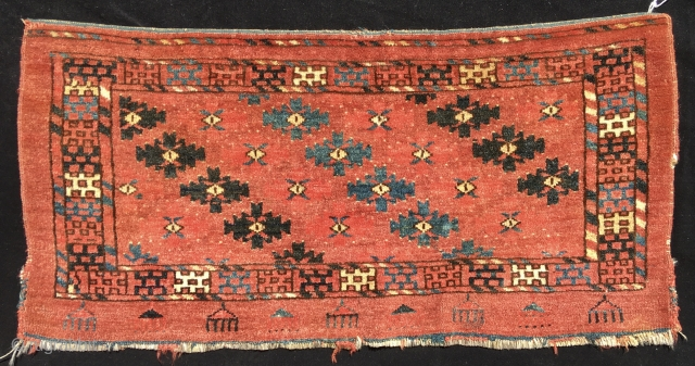 A very nice little Yomut mafrash face.  Size is 32 inches x 16 inches. (82 cm x 41 cm).  Colors are all good.  Two subtly different madder reds, a  ...