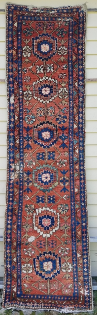 """Heriz runner - about 31"""" x 99"""".  Nice color, bold design, meaty pile except for moth damage at ends and left of center which should be an easy fix."""