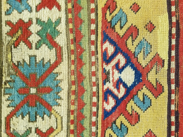 Kazak - about 8.9 x 3.7, Beautiful saturated color, wear areas throughout, newer side cords, overall repiling (mostly of ivory and yellow) and other scattered repairs/reweaves.