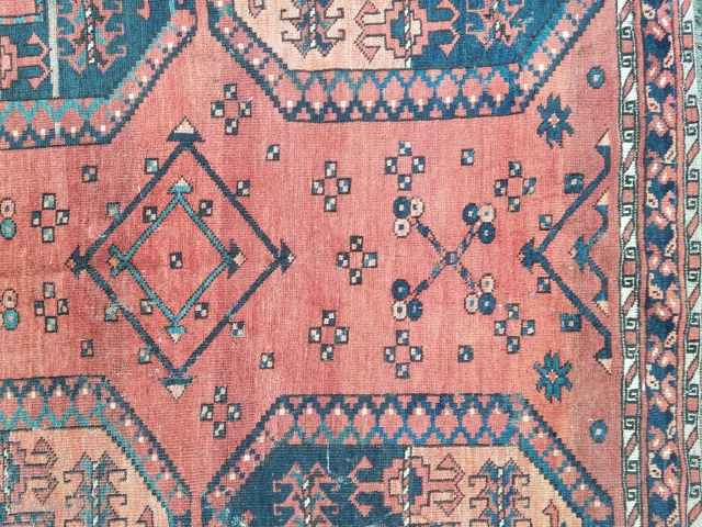 Ersari main carpet measuring about 7.7 x 9.1 with considerable mothing.