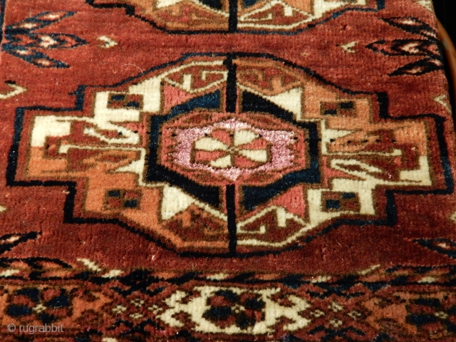 old  antique tekke torba with excellent+ pile - sold years ago in this catalog by a noted english dealer - corroded rose silk centers -