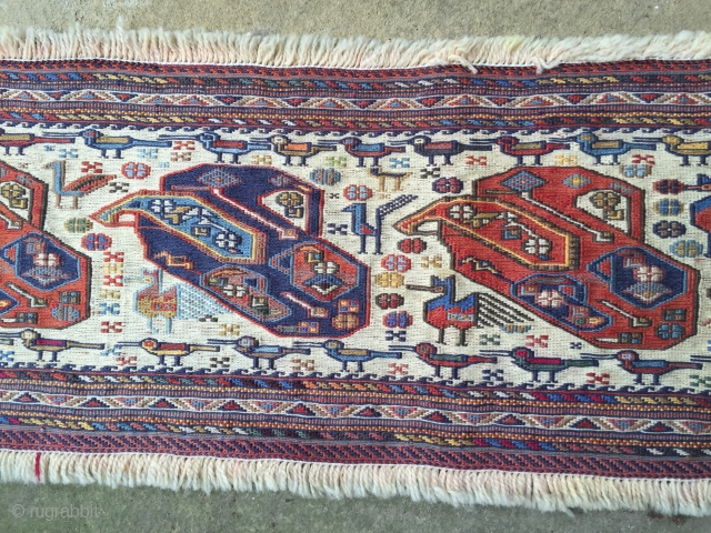 Very pretty and very fine Soumac hanging complete with almost a whole zoo  Wonderful quality and perfect condition. 52.5inches x 11inches