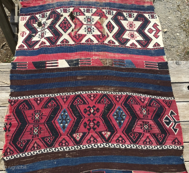 Malatya kilim strip. Cm 90x415. Second half 19th c. Wool, cotton and metal thread. White is cotton. Cochineal red and different blues. Ram horn pattern. Great character, great aura. Beaten, with holes,  ...
