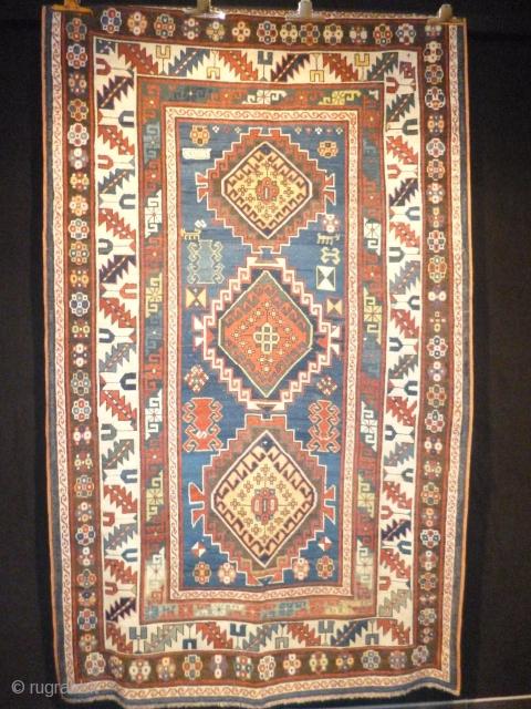 Kazak (Karachop?) really archaic piece XIX th Century cm150x250cm.Some small replaced areas ,original heads