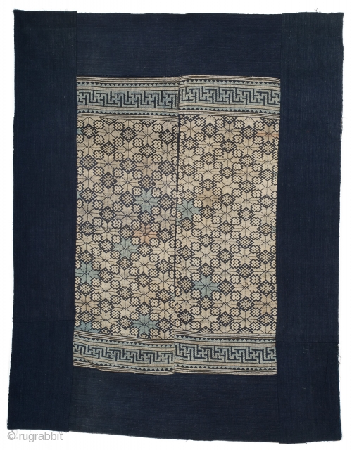 A Tu Jia blanket from Hunan province, China. Cotton foundation with cotton supplementary weft design in two loom-width panels. Original indigo blue border. Central part measures 75cm x 110cm, overall dimension 122cm  ...