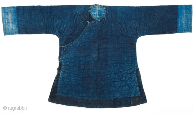 An indigo padded winter jacket for daily use, from Guangxi province, Southwestern China. Cotton, with cotton padding. 19th Century. 134cm x 73cm.  This is a Miao minority jacket, however it is essentially the  ...
