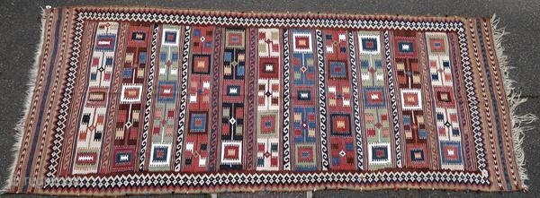 Ghashghai kilim from the early 20th century.  Origin : Persia Period : early 20th century Size : 350 x 143 cm Material : wool on wool Good general condition, some snags Vegetable dyes Handwoven  This kilim has been cleaned by  ...