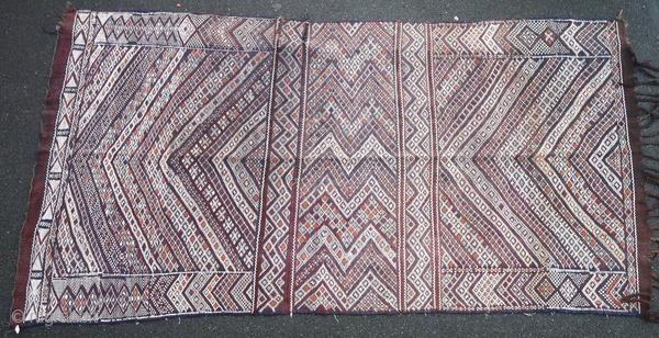 Berber kilim from the Middle Atlas in Morocco, made in 1950 or before, and in good general condition with two tears. This authentic piece has not been woven for trade.  Origin : Morocco Period  ...