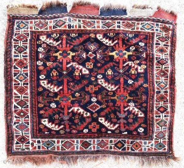Ancient Ghashghai bag face. Good general condition.  Origin : Persia Period : early 20th century Size : 64 x 57 cm Material : wool on wool Good general condition Vegetable dyes Handwoven  This rug has been cleaned by a professional.  ✦  ...