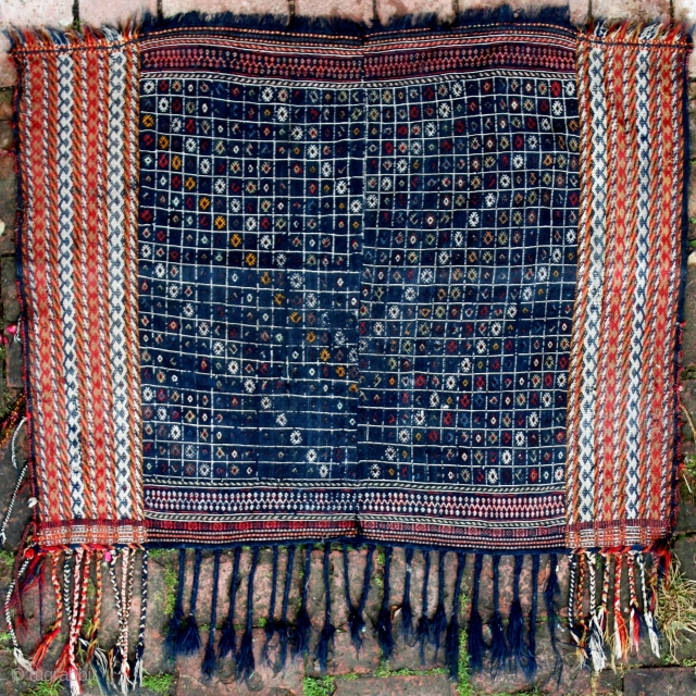 A quite rare Qashqai horse cover, 137x108cm. The warp-float patterning technique in the two outer pannels is often attributed to the Darreshuri Qashgai.