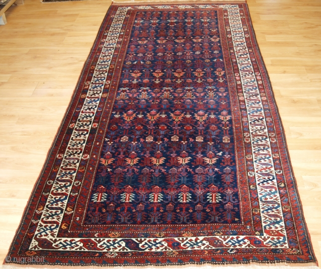 Antique Kurdish kelleh long rug with dragon border. www.knightsantiques.co.uk   Circa 1900  A very good quality rug with excellent colour, the rug is very well drawn with an all over repeat design of shrubs  ...