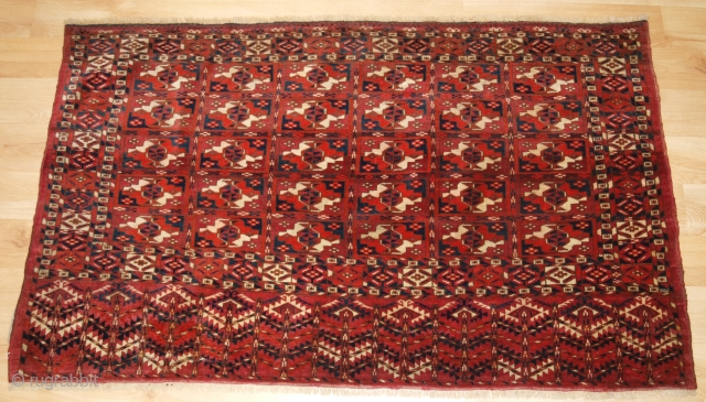 Antique Tekke Turkmen chuval with the boxed chuval gul design. www.knightsantiques.co.uk   Late 19th century.  The chuval is well drawn with excellent colour. The design is 30 small boxes containing chuval guls. The elem  ...