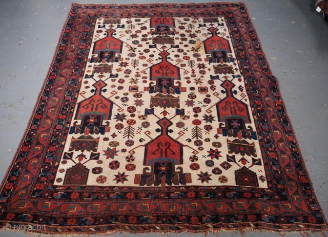 Antique Afshar Neriz rug of repeat shield design on an ivory ground. www.knightsantiques.co.uk 