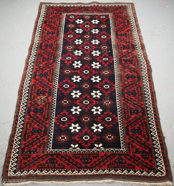 Antique Baluch rug from Western Afghanistan / Eastern Persia. A Baluch rug with a mina khani design on a dark indigo blue field. www.knightsantiques.co.uk 