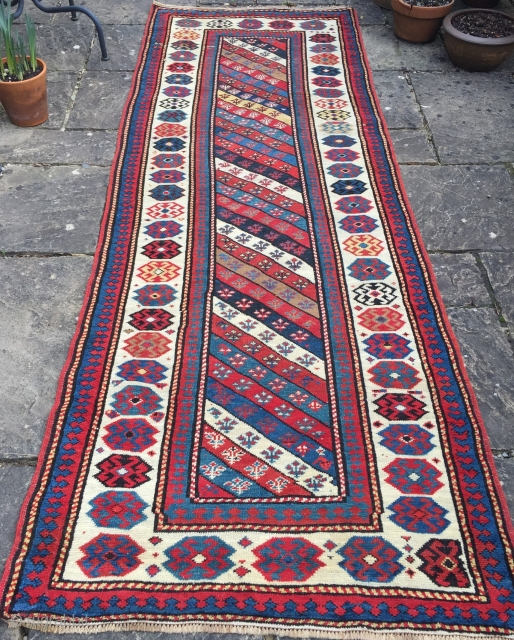 Antique Caucasian Gendje Kazak runner with diagonal stripe design. www.knightsantiques.co.uk  Size: 9ft 5in x 3ft 4in (287 x 101cm).  Circa 1880.  A good example with excellent colour and a striking ivory ground border. The  ...