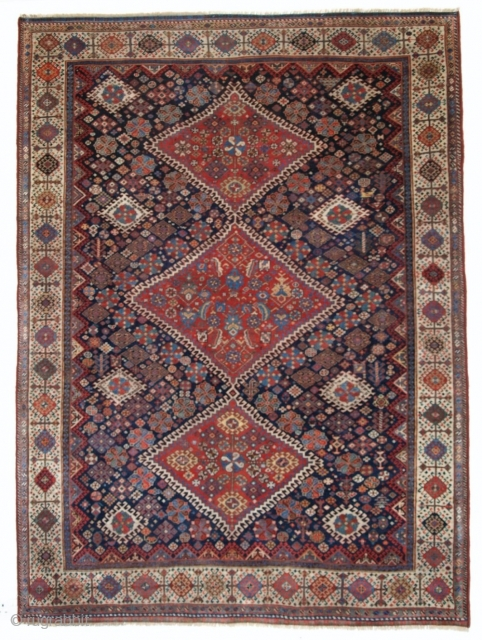 Antique Qashqai rug, with triple latch hook medallion design, outstanding drawing and colour. The medallion is surrounded by a field filled with floral rosettes and tribal design elements.  Size: 7ft 0in  ...