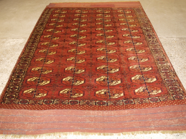 Antique Tekke Turkmen main carpet with 4 rows of 12 octagonal guls. www.knightsantiques.co.uk Size: 9ft 6in x 5ft 11in (290 x 180cm).   Mid 19th century or earlier.  A rare Tekke Turkmen main carpet,  ...