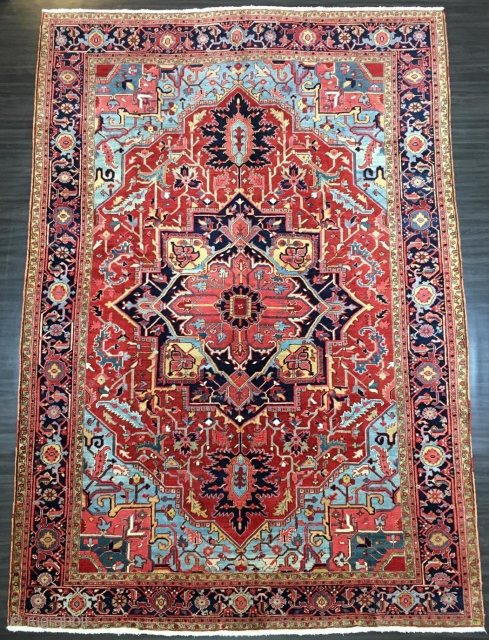 Antique Heriz carpet with a very well-drawn and striking large medallion with superb colours through out. www.knightsantiques.co.uk  Size: 12ft 10in x 9ft 0in (390 x 275cm).   Circa 1900.  The carpet has a large  ...