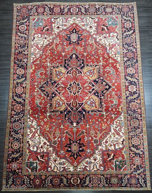 Antique Heriz carpet with a very well-drawn and striking large medallion on a madder red field. www.knightsantiques.co.uk 