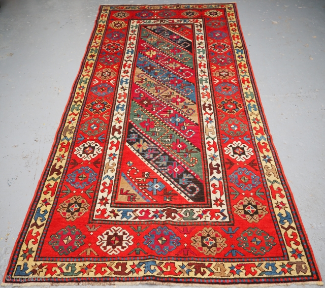 Antique Caucasian Gendje Kazak long rug with diagonal stripe design. www.knightsantiques.co.uk  Size: 8ft 11in x 4ft 0in (271 x 123cm).  Circa 1890.  A good example of a Gendje long rug, multi coloured stripes  ...