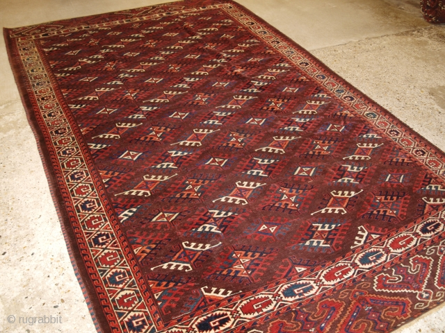 Antique Yomut Turkmen main carpet with the 'Dyrnak' gul design and curl leaf border. www.knightsantiques.co.uk   Circa 1890.  The carpet has a rich brown ground colour with some very nice blues, greens, ivory and  ...