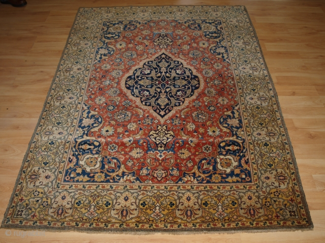 Antique Persian Sarouk rug of classic small medallion design, with floral sprays on an terracotta red ground. www.knightsantiques.co.uk   Circa 1900.  This is a classic example of a Sarouk rug, well drawn with good  ...