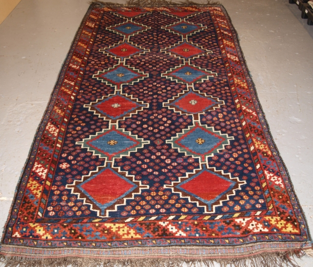 Antique South West Persian Luri tribal long rug with linked medallion design. www.knightsantiques.co.uk   Circa 1900/20.  The rug is of typical Luri design, bold linked medallions with vibrant colour. This is a striking rug  ...