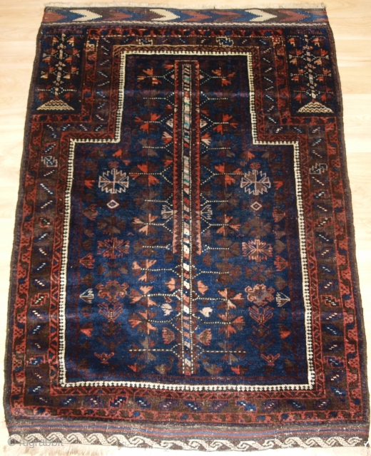 Antique Baluch blue ground prayer rug with 'tree of life' design. www.knightsantiques.co.uk   Late 19th century.  A good blue ground Baluch prayer rug with tree of life design to the field. The hand placements  ...