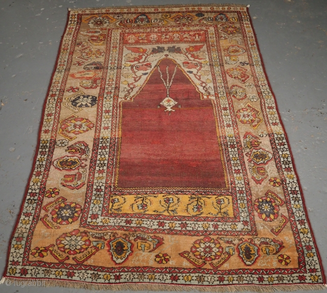 ***£695/$925*** Antique Turkish Oushak region prayer rug of classic design with soft pastel colours. www.knightsantiques.co.uk  Size: 5ft 11in x 3ft 8in (180 x 111cm).  Late 19th Century.   The rug is of a traditional  ...