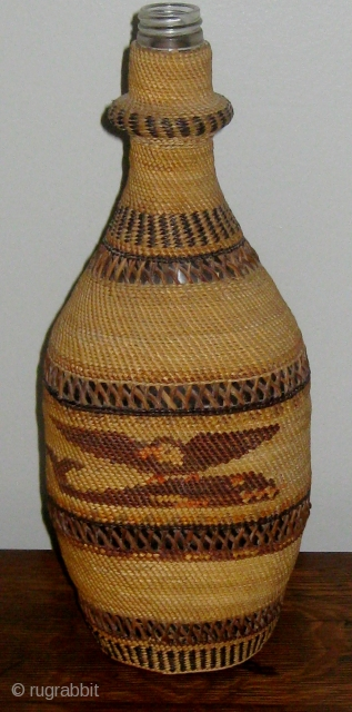 Antique Native American Northwest Coast Nootka-Makah polychrome twined bottle basket, consisting of a bottle covered with fine weave of cedar bark and bear grass.  Solid bands alternating with open lattice work.  ...