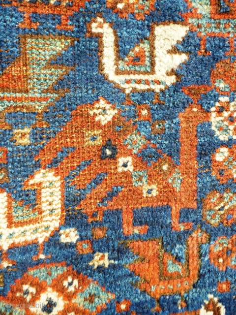 Murgh Carpet, Qashqai'i motifs on a Khamseh piece. Pile medium to low - see photos i.e. central emblem & field edges low - see penultimate photo. Ends intact and secured. Sides tatty  ...